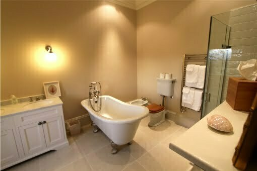 Luxurious large bathroom with traditional features